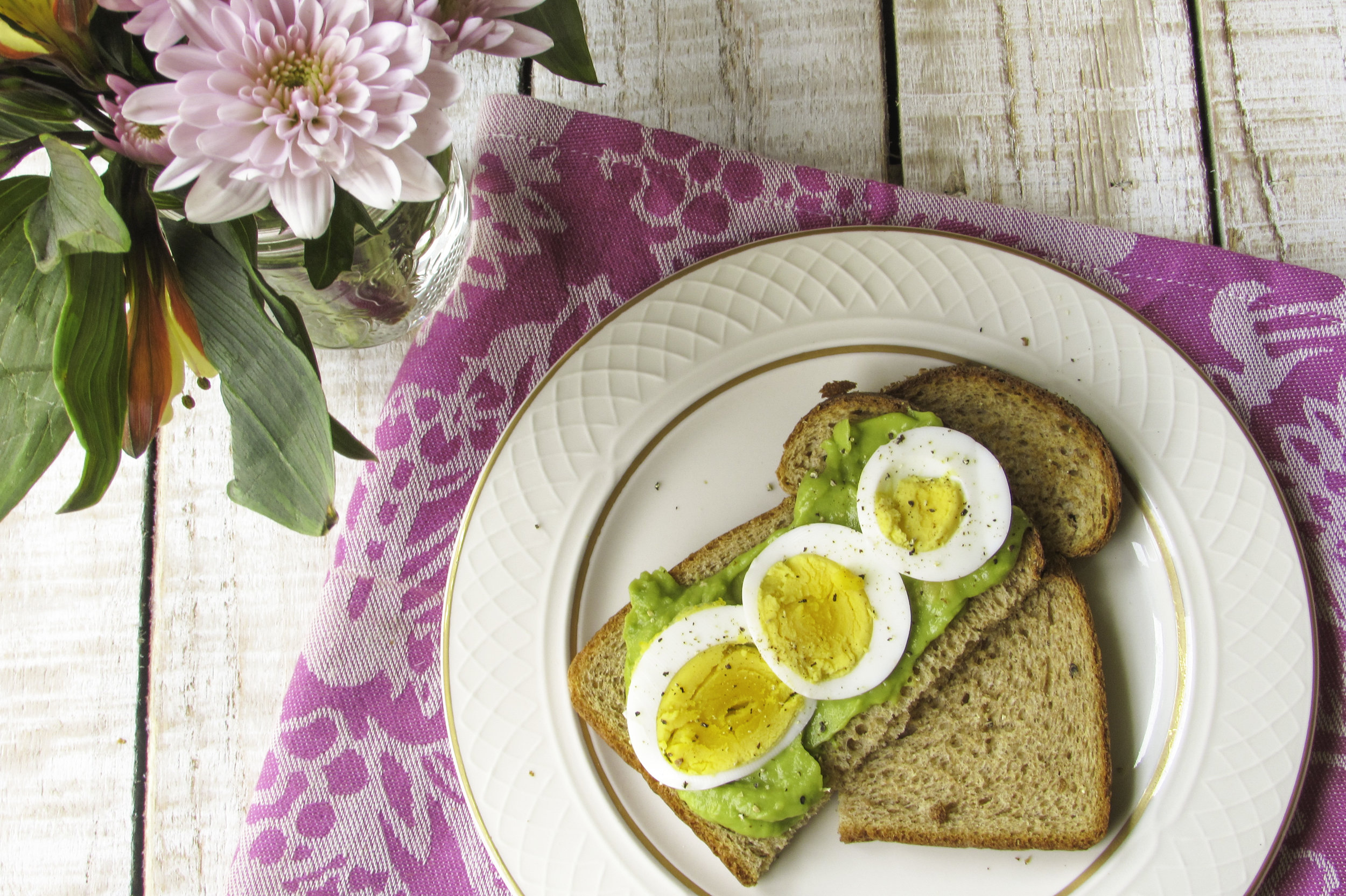 Guacamole, hard-boiled egg slices and fresh ground black pepper