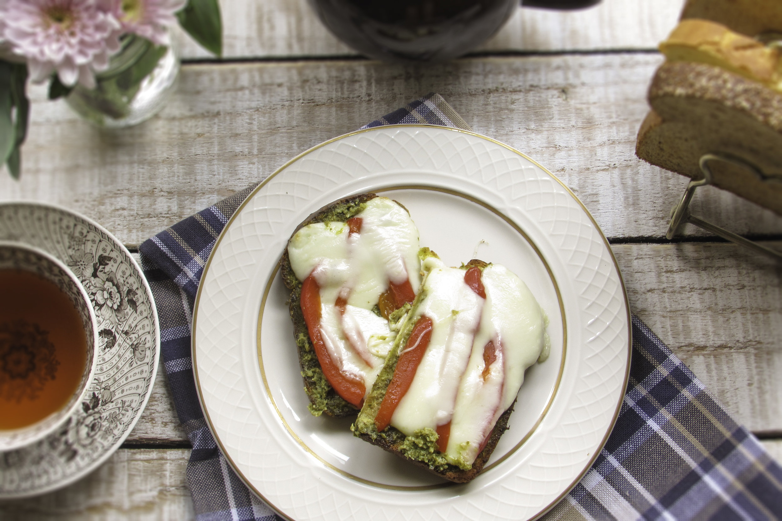 Pesto, roasted red pepper slices and mozzarella cheese