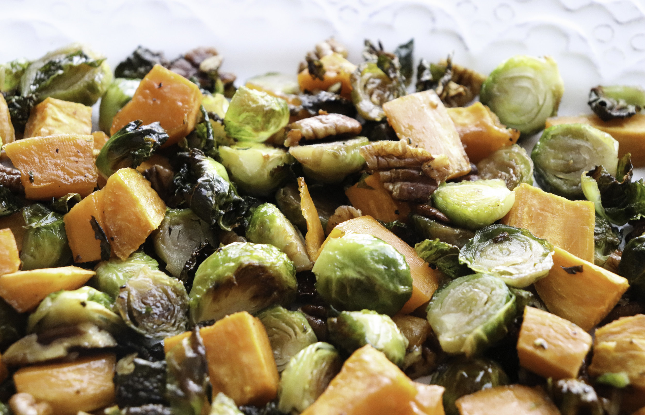 Pecan Pie Glazed Sweet Potatoes and Brussels Sprouts - love the little crispy leaves!