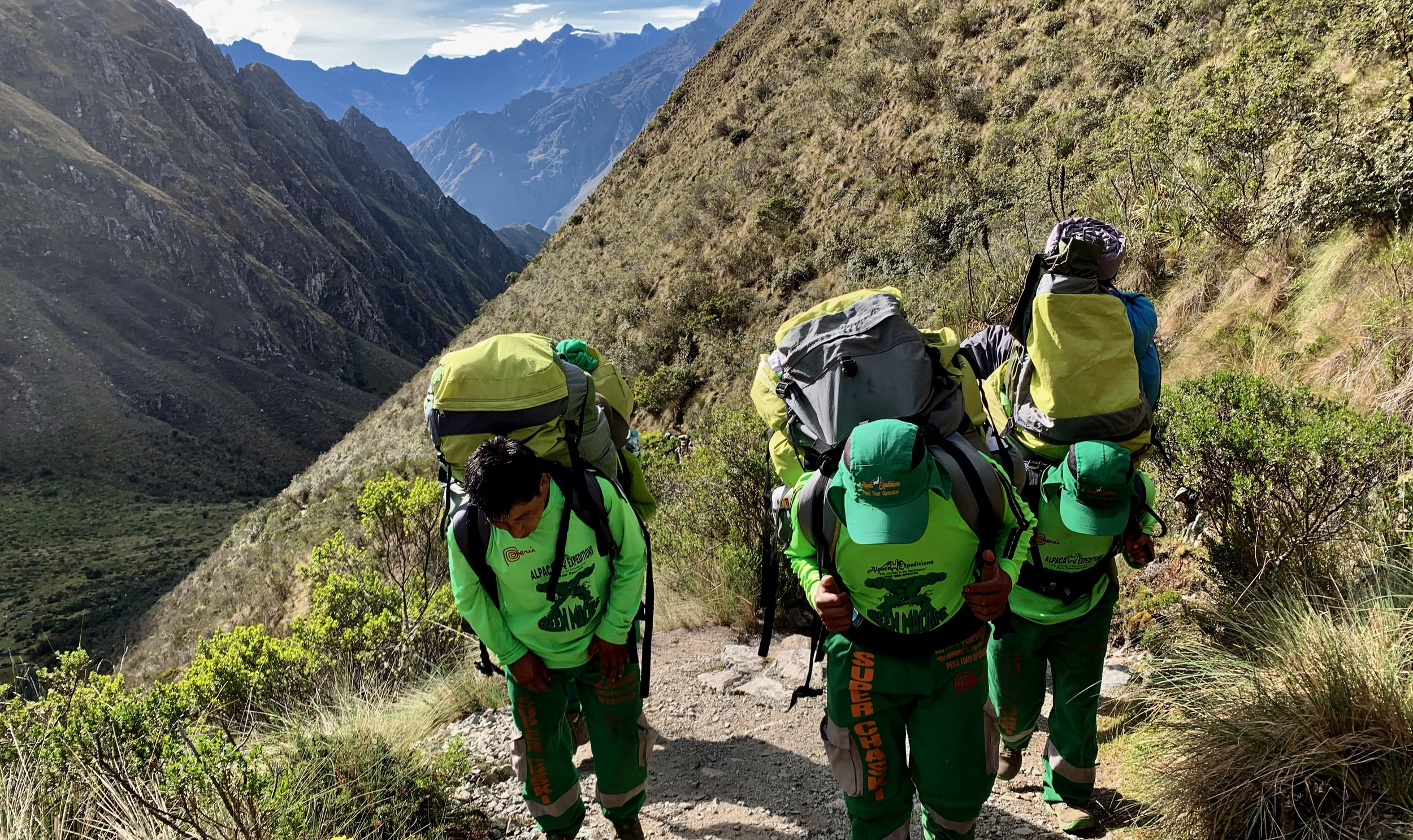 "Our incredible porters, nicknamed ""The Green Machine"" and ""Super Chaskis"""
