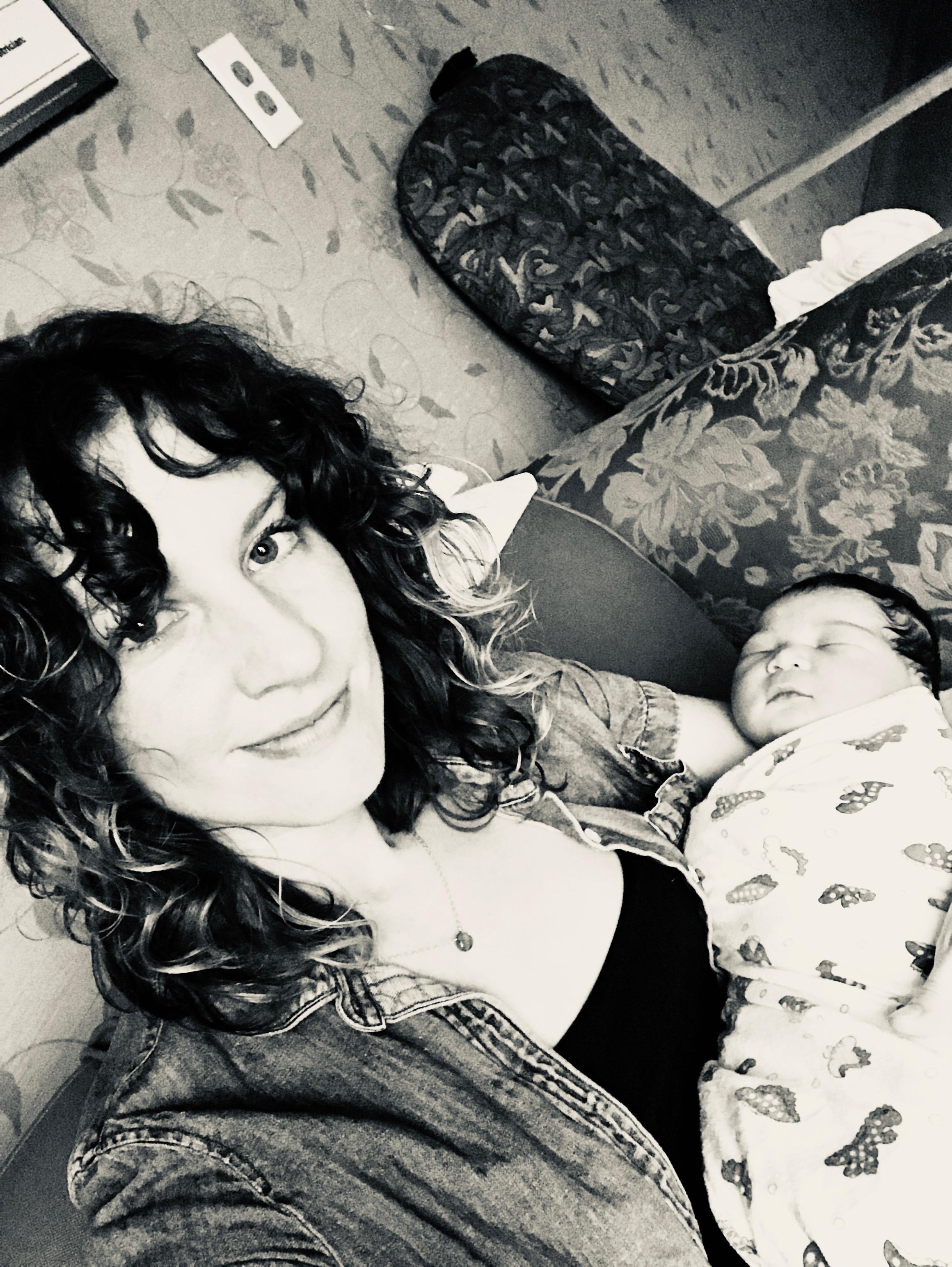 Sierra holding the newborn Naomi