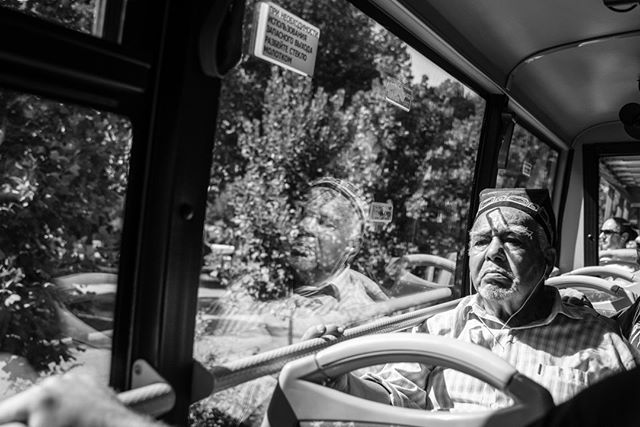 Self Reflection. September 1, 2018. Tashkent, Uzbekistan. . . . . . . . . . #reflection #travelphotography #publictransit #Uzbekistan #streetphotography #adventure #public #oldman #bus #mirror #glass #travel #blackandwhitephotography #photographer #street #tashkent #art #asia #thought #self #hat #contrast #shadow #nikon #ride #look #mood