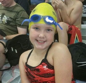 Raegan gearing up for a swim meet, Winter 2015
