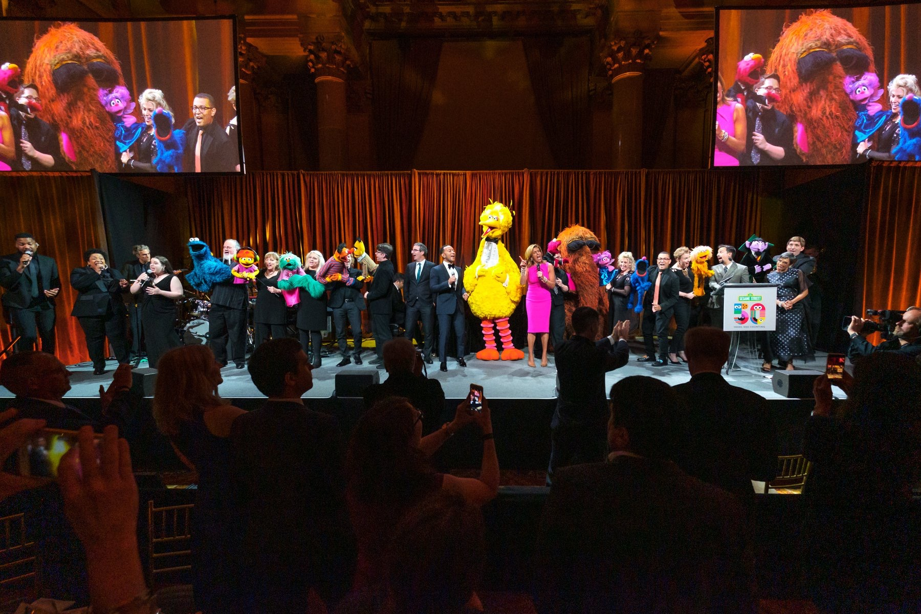 On stage with John Legend at the Sesame Street 50th Anniversary Gala