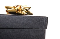a black gift box with gold bow