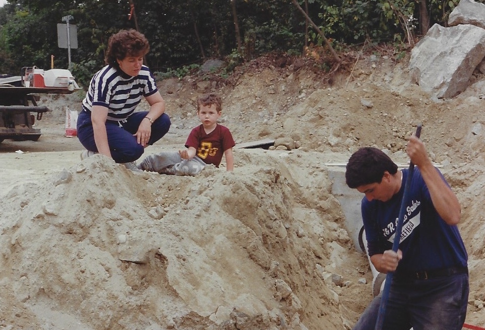 Clare, Jay, and Joe with the shovel working on subdivision in 1989