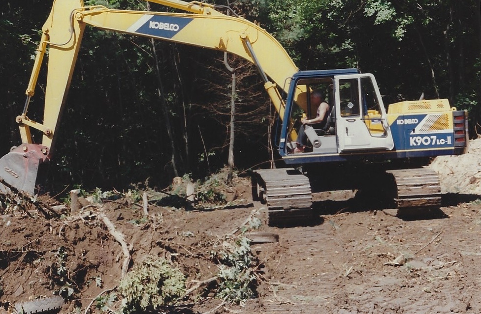Ralph in an excavator on job site in 1990