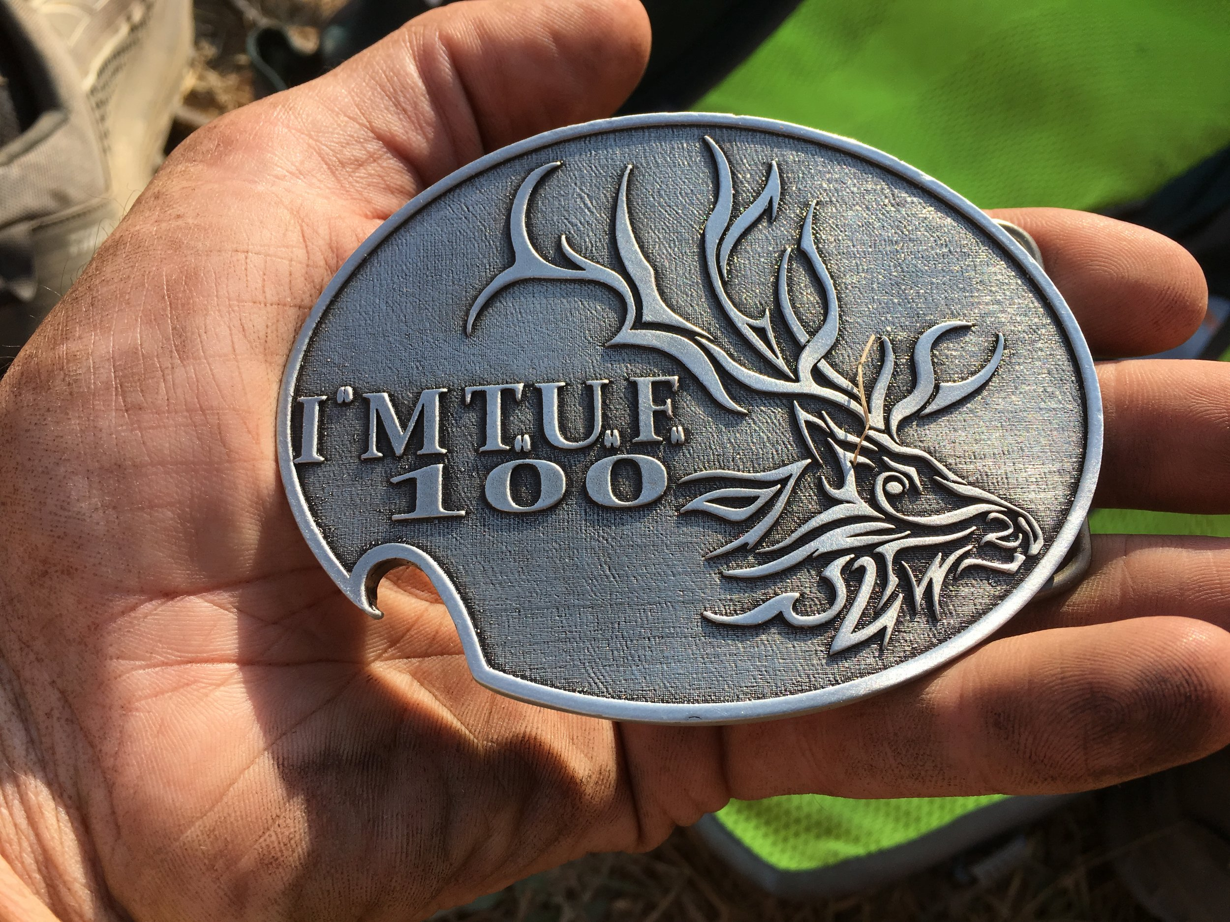 Nailed it! This was my first finish of IMTUF and my fifth 100-mile buckle. Notice the intentional notch that is perfect for popping bottle caps to toast a successful run.