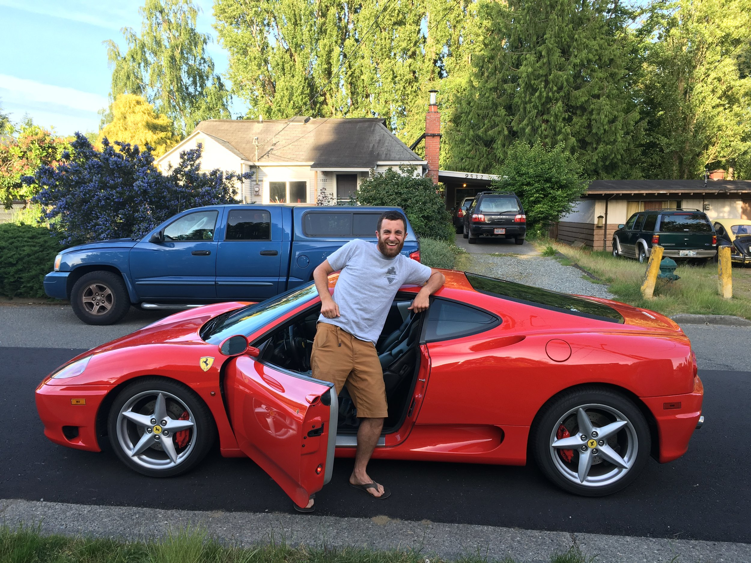 No, not my ride. I'm posing next to a friend's ridiculous, but sext Ferrari.