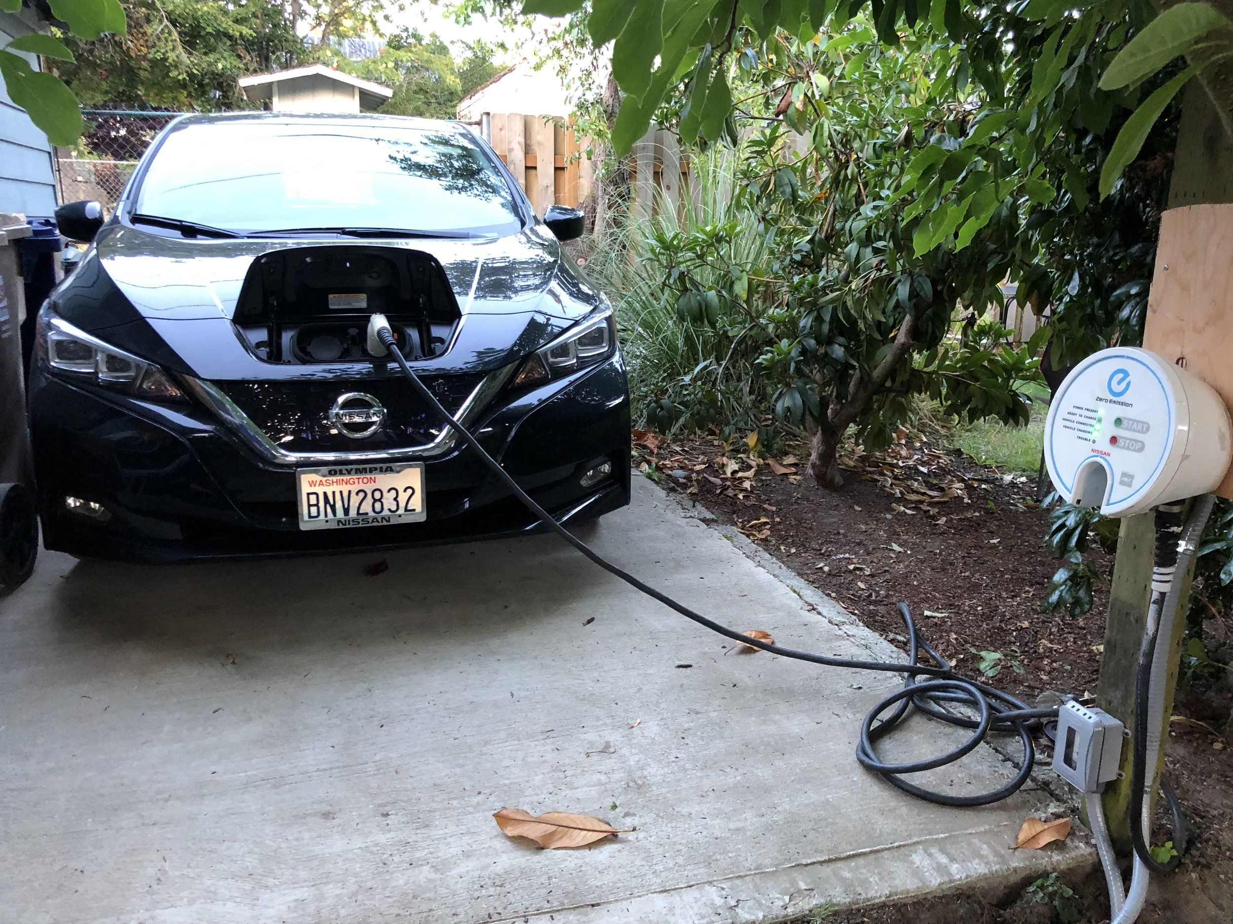 After charging my car using a 110v outlet and extension cord for several months, I eventually wired up a used 220v charger in my back parking spot.