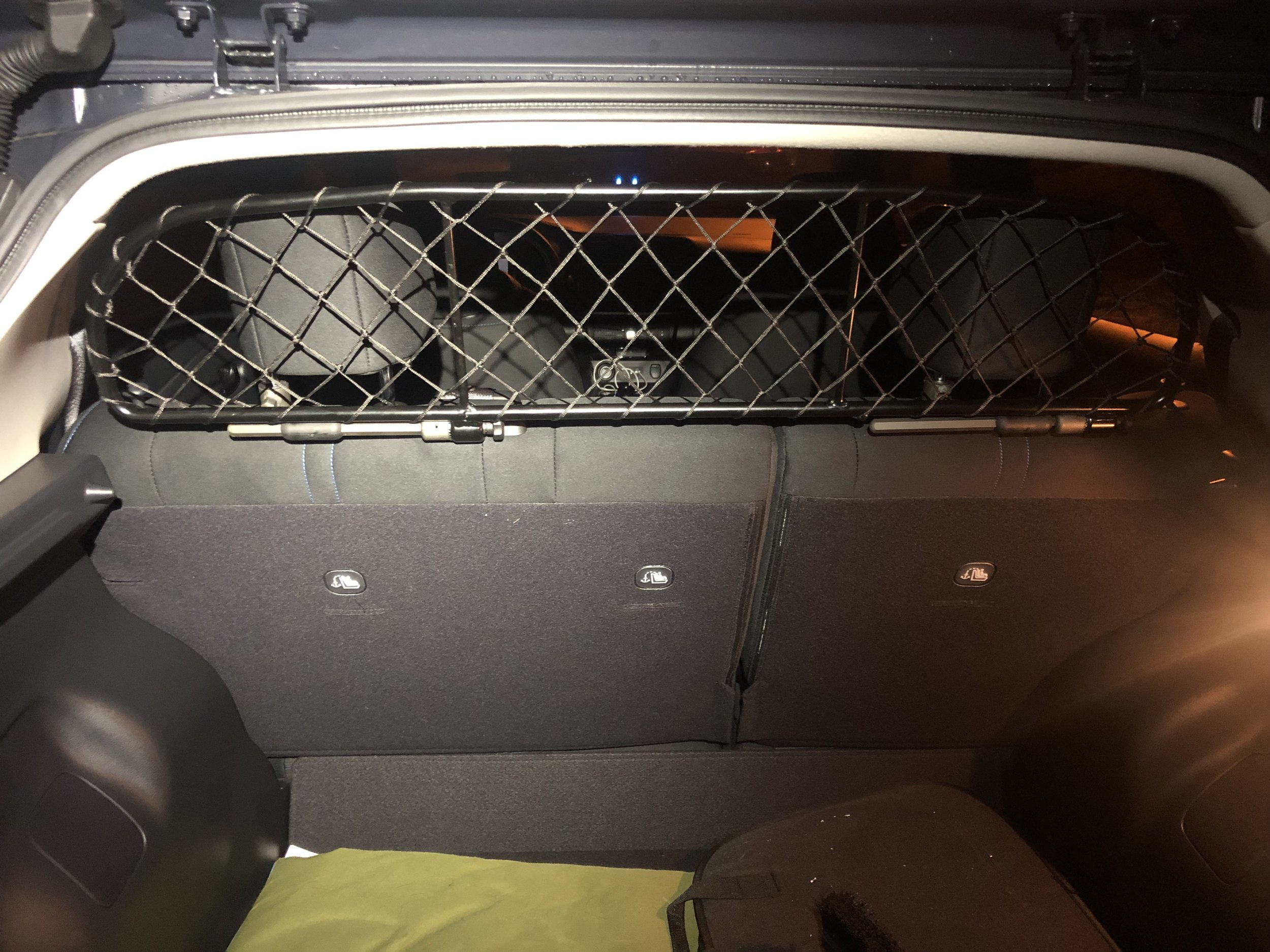 The only aftermarket product I added to my car is a pet barrier. This installs against the rear seats to ensure my Border Collie stays in the rear cargo area. She is a little Houdini, but has yet to break out.