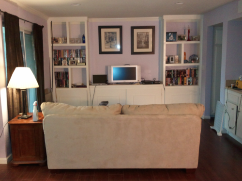This is an example of a living room that has potential, but lacks a good aesthetic.