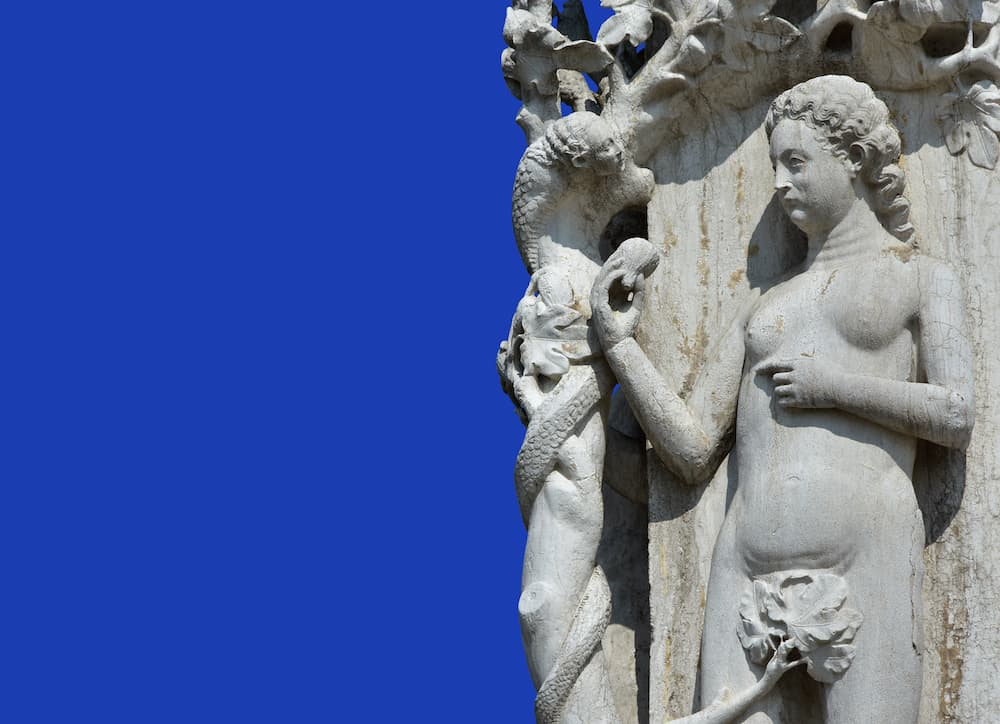 fig- DOWNLOAD PREVIEW  Snake tempts Eve in the Garden of Eden, a medieval sculpture in Saint Mark Square, Venice dreamstime_xxl_71073775.jpg
