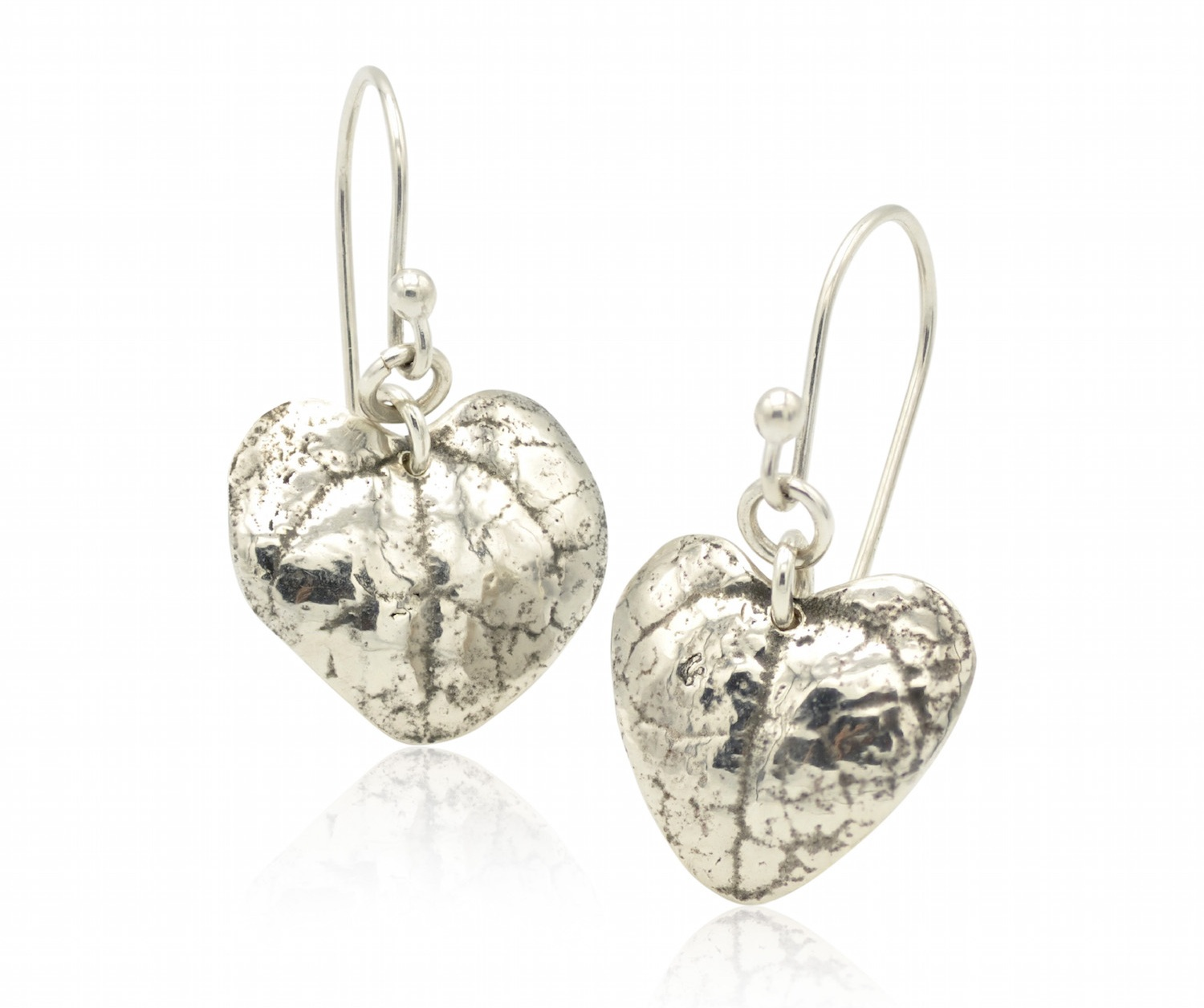 string of hearts silver earrings 1.jpg