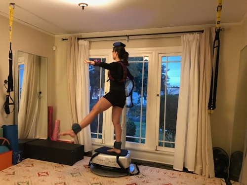 Ballet with weights on a vibrating platform in front of mirrors.Strength and stability like this is not available from water exercise.