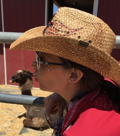 Kissing an alpaca at the Orange County Fair.