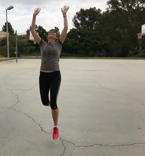 Leaping to shoot basketball in the park.