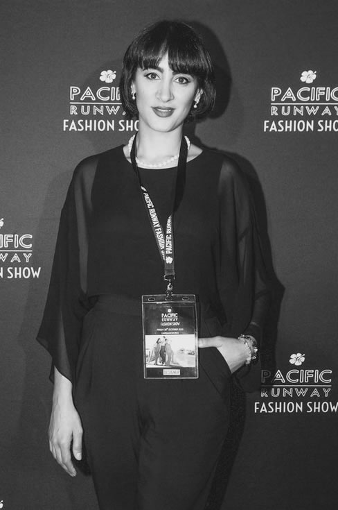 Fashion Designer Lena Kasparian by the media wall. (Image by: Cyclone Imaging)