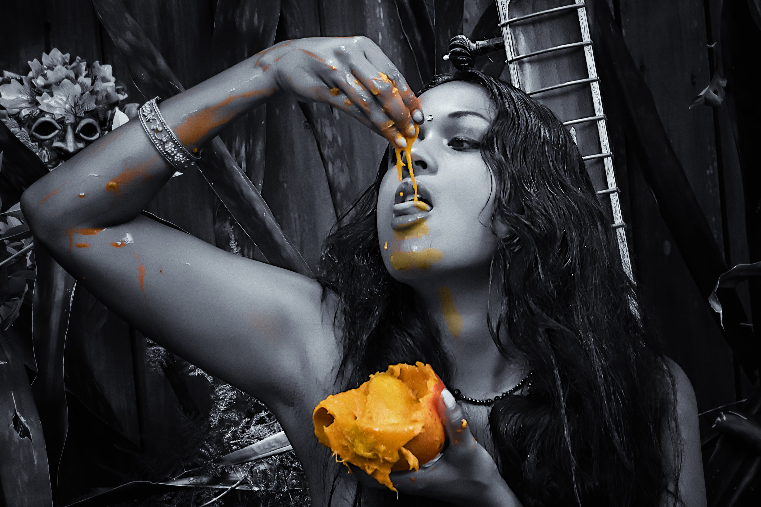 Dita enjoys a refreshing mango.