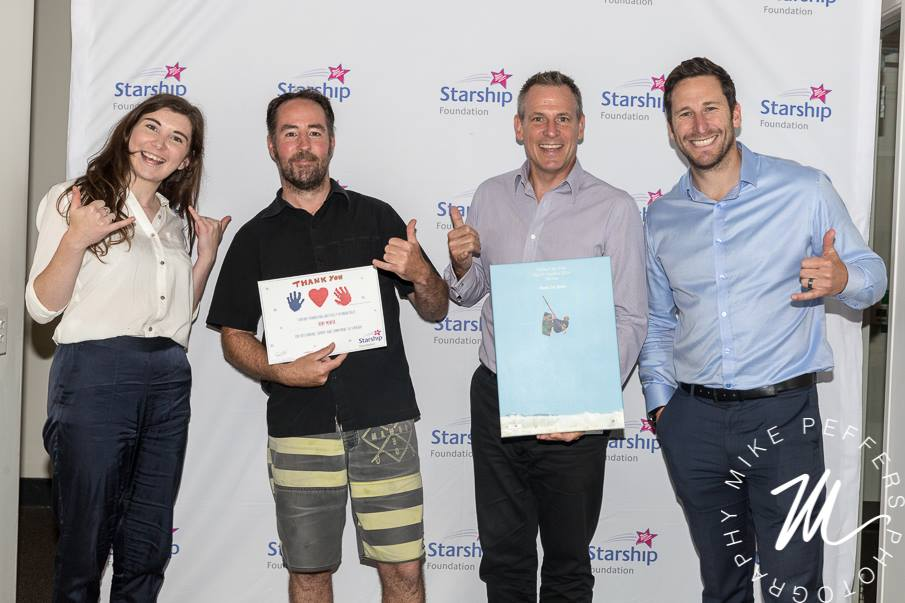 Kent and Juan handing over the money raised in 2016 to Brad and Krissy from Starship Foundation