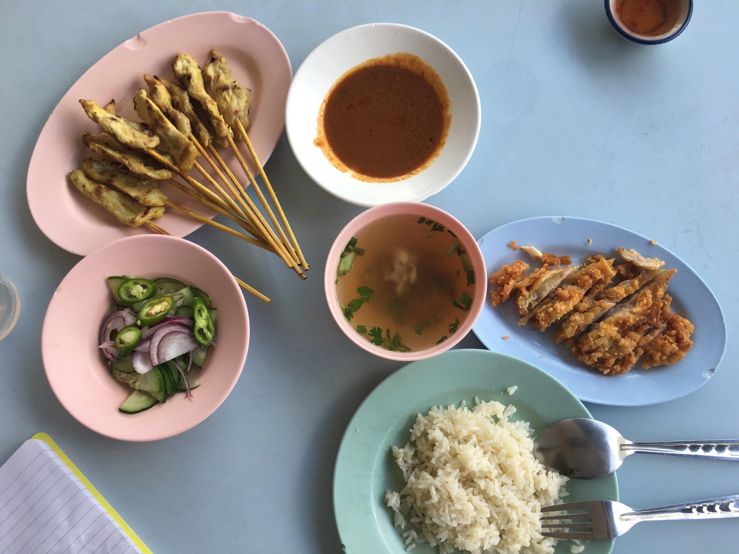 Pork satay, crispy chicken with sweet chilli sauce, steamed rice, chicken/pork broth & pickled cucumber salad