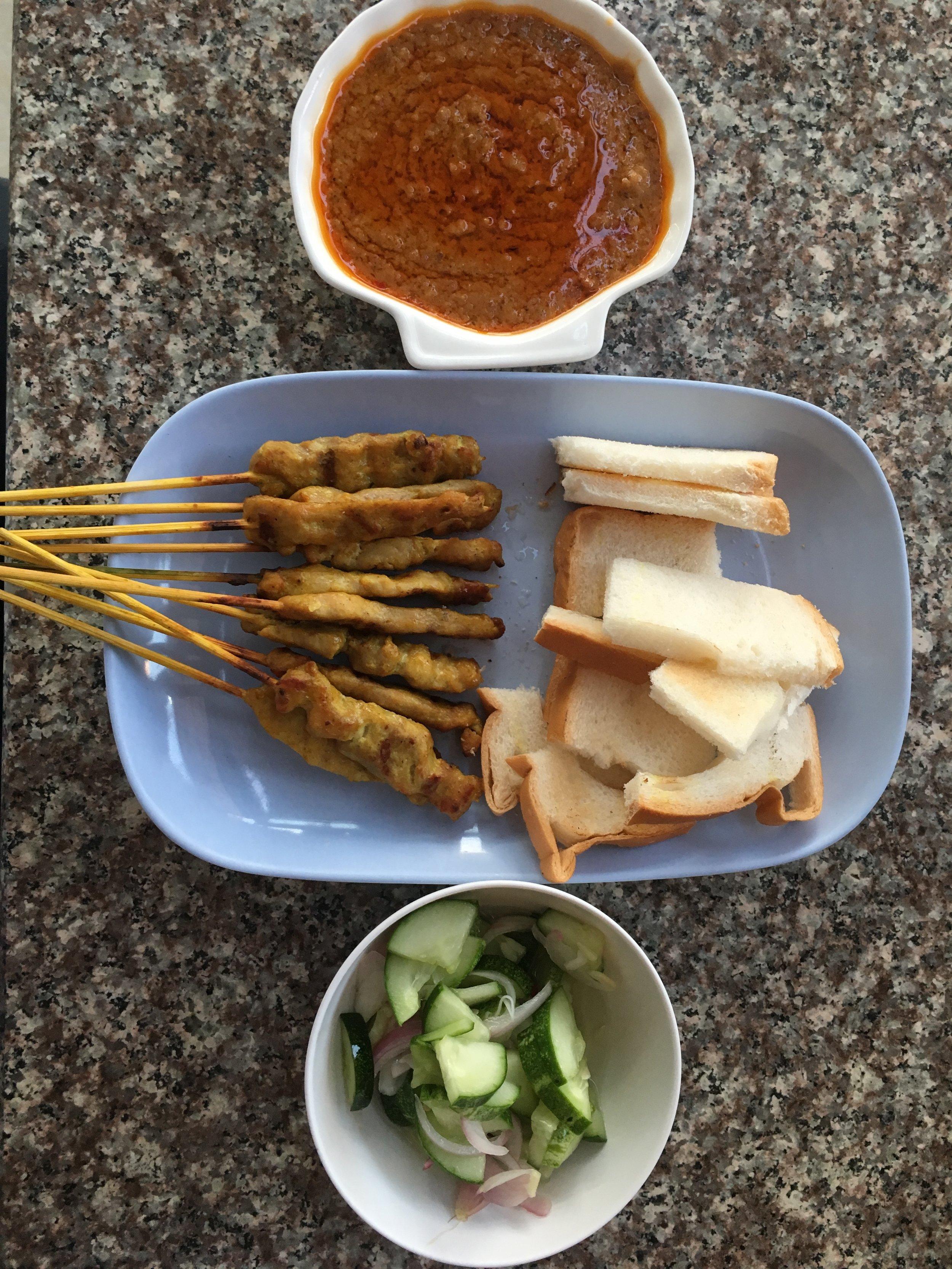 Satay chicken with pickled cucumber salad at Sa la van restaurant, Vientiane. Find it!