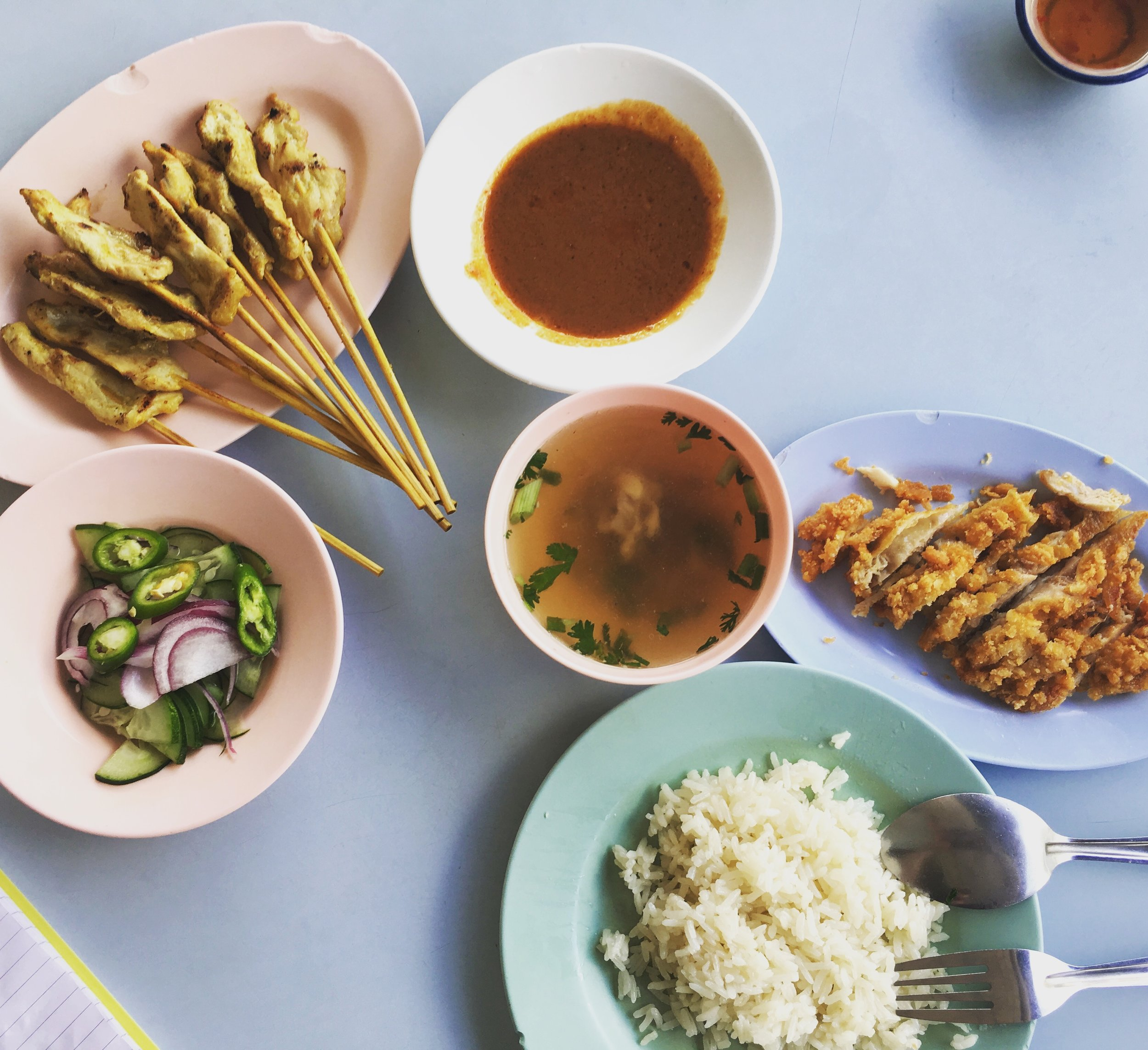 Pork satay, crispy chicken, cucumber, chilli and red onion salad and steamed rice.