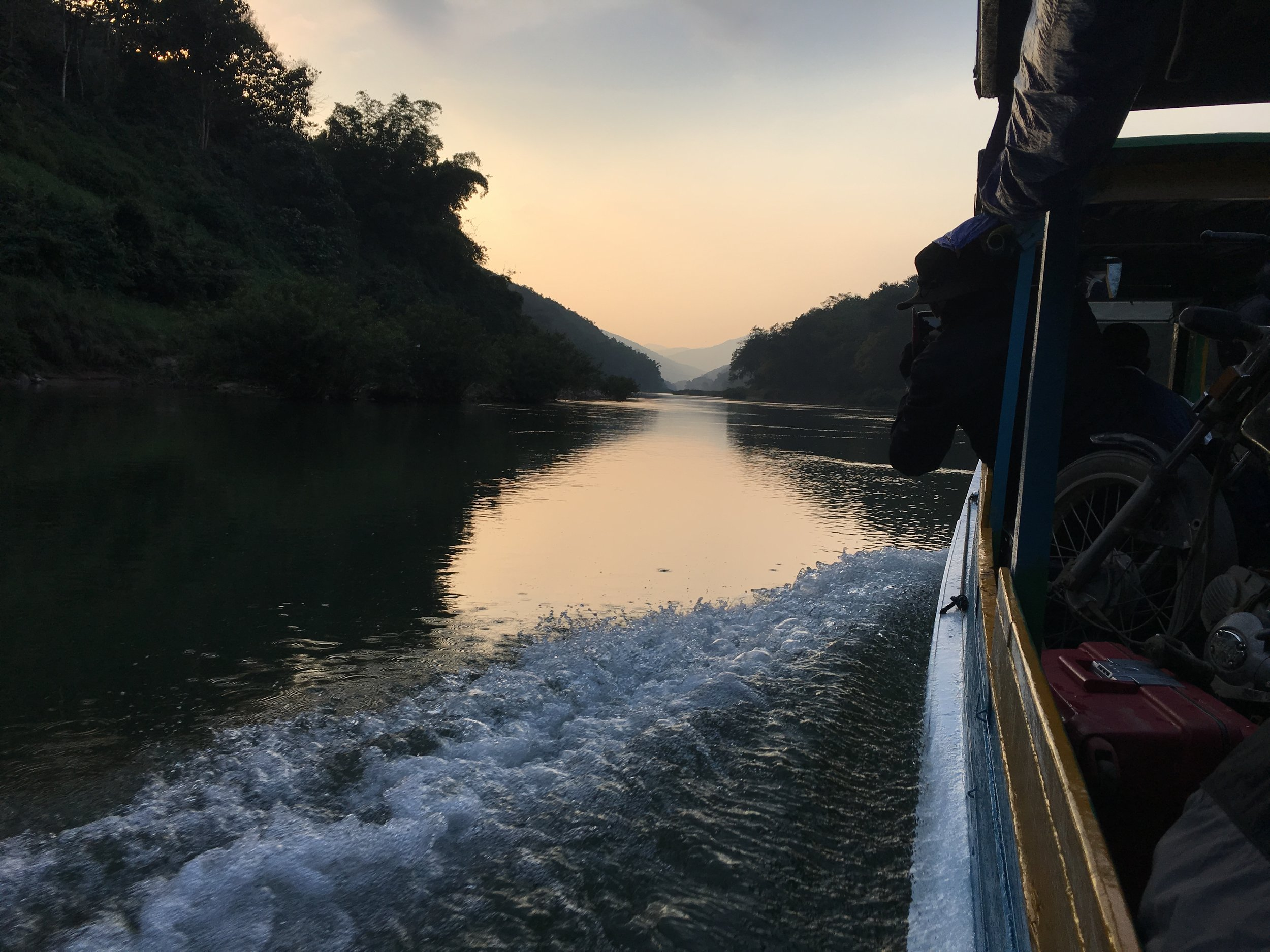 With the sun setting and the boat sinking on the Nam Ou River, it seemed we were in a race against time.