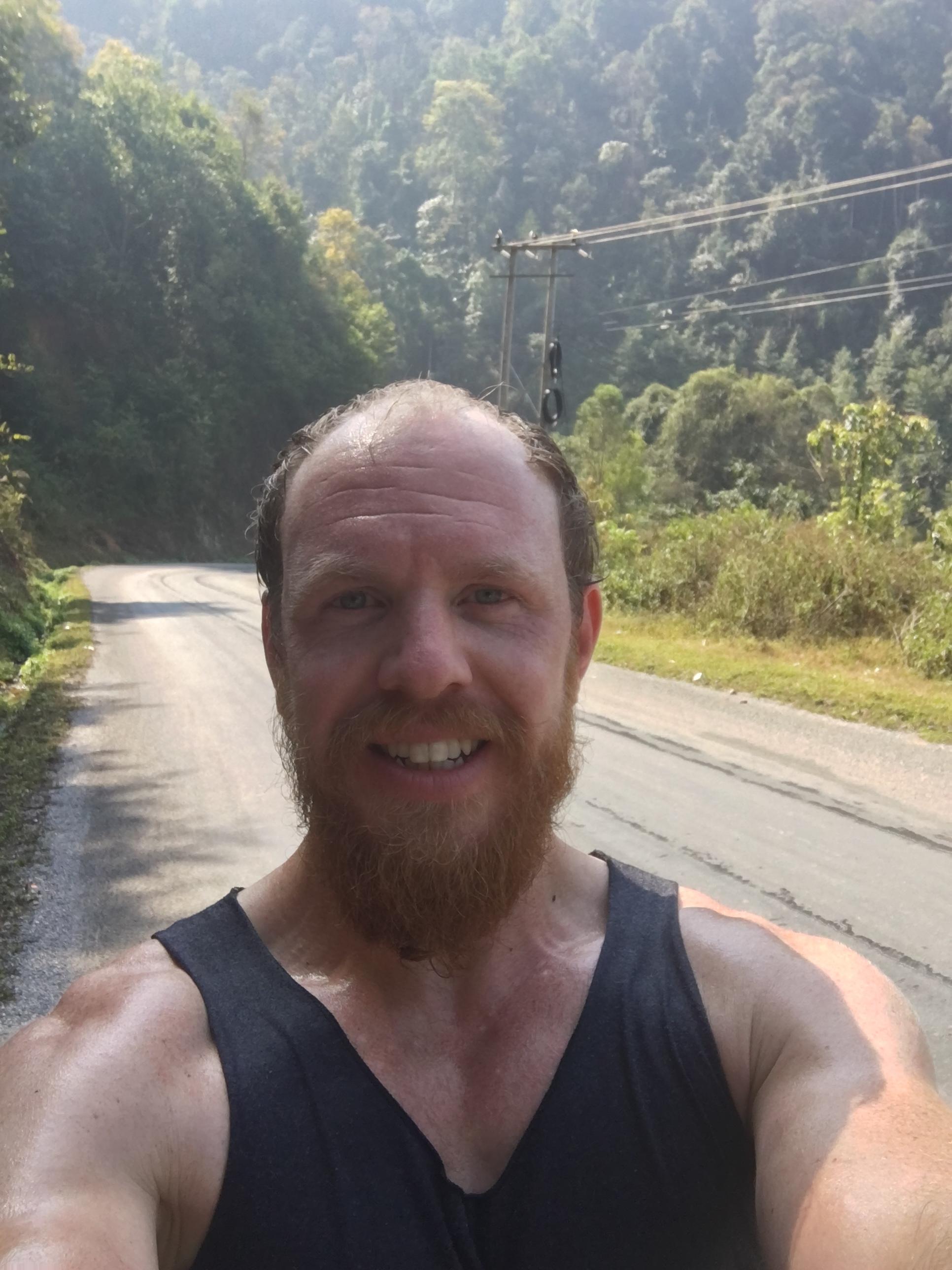 A very sweaty me on a tough, uphill climb.