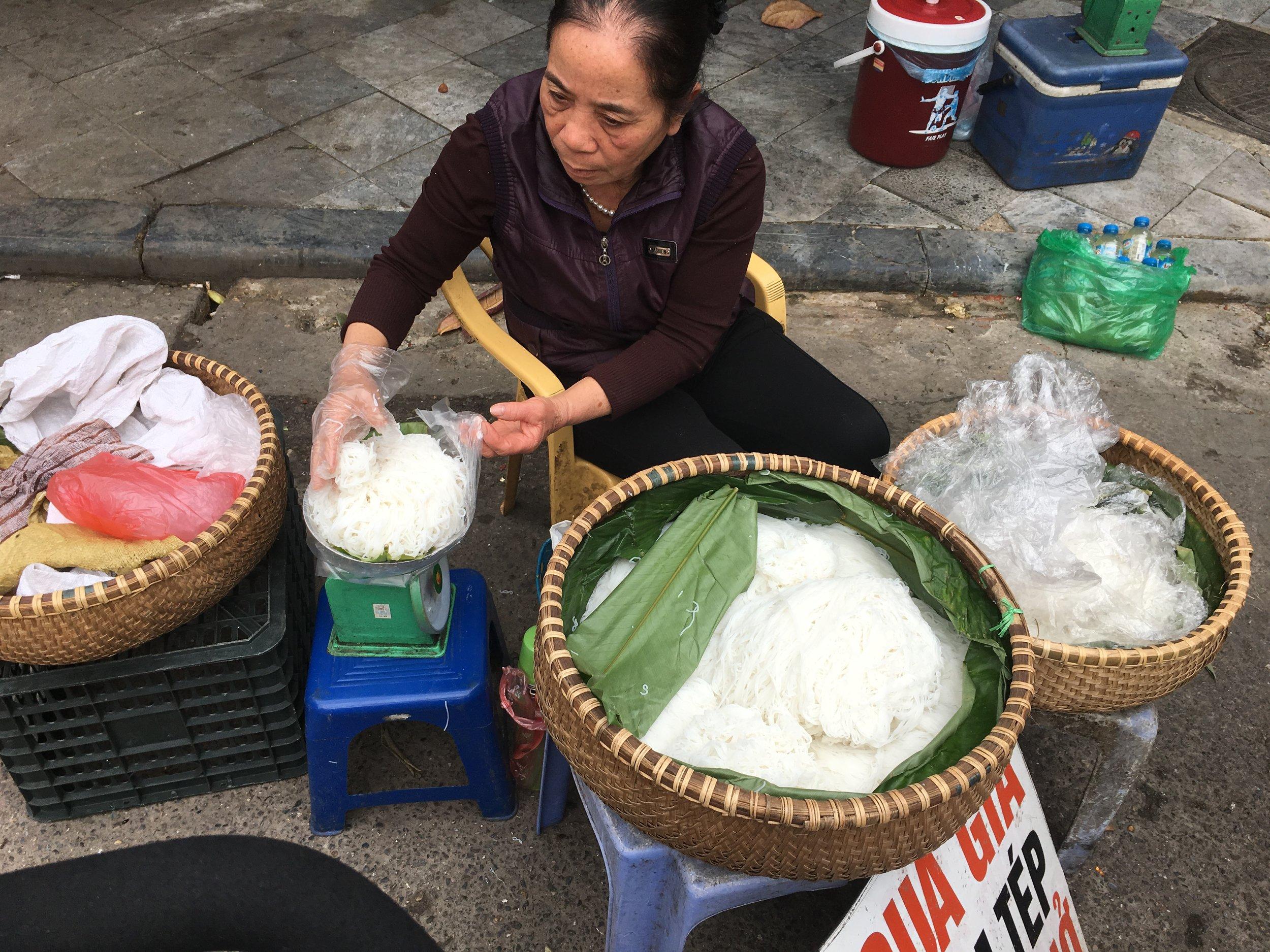 Street market Hanoi. Oodles of fresh noodles.