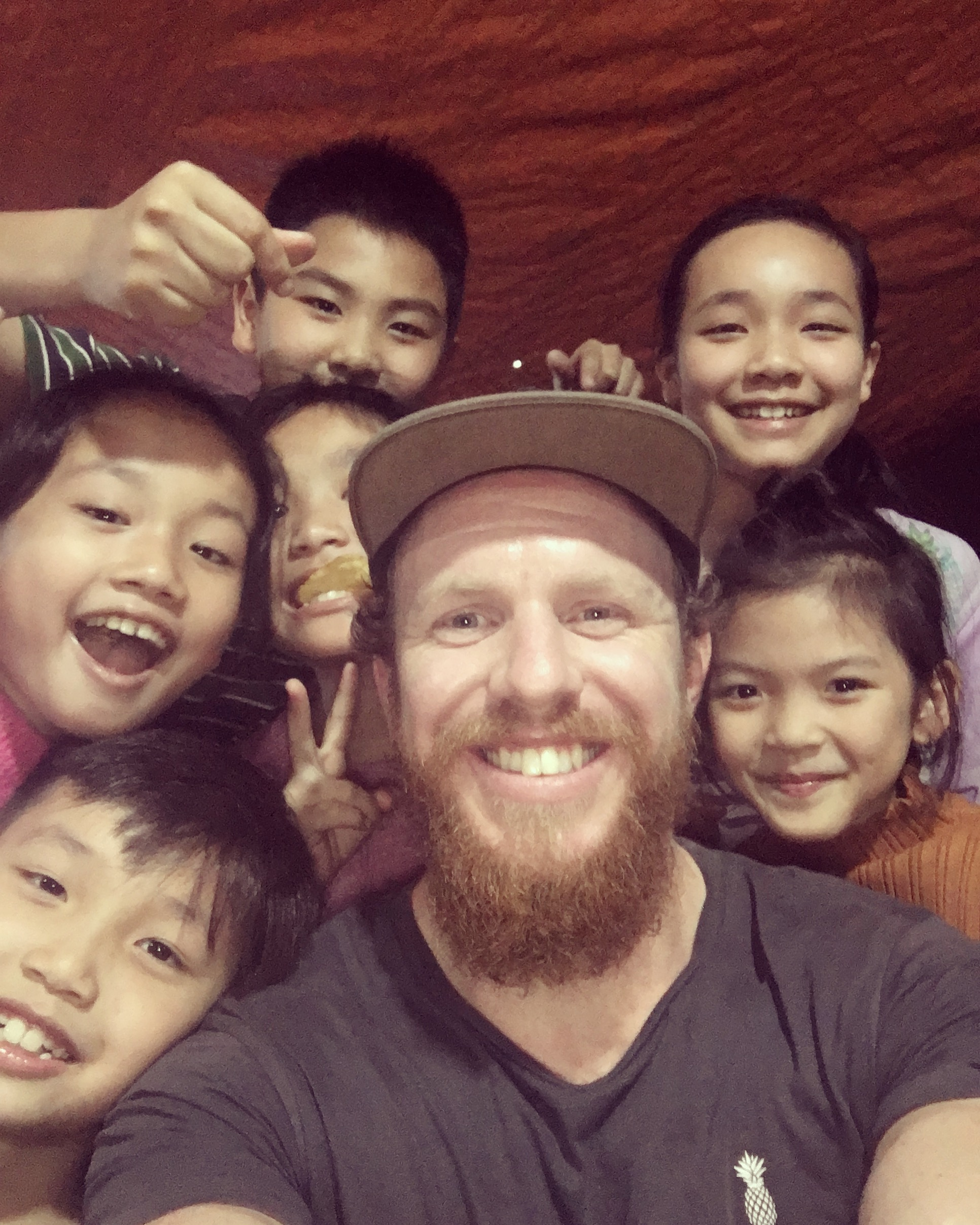 Me with a group of friendly kids celebrating a birthday in Hai Phong.