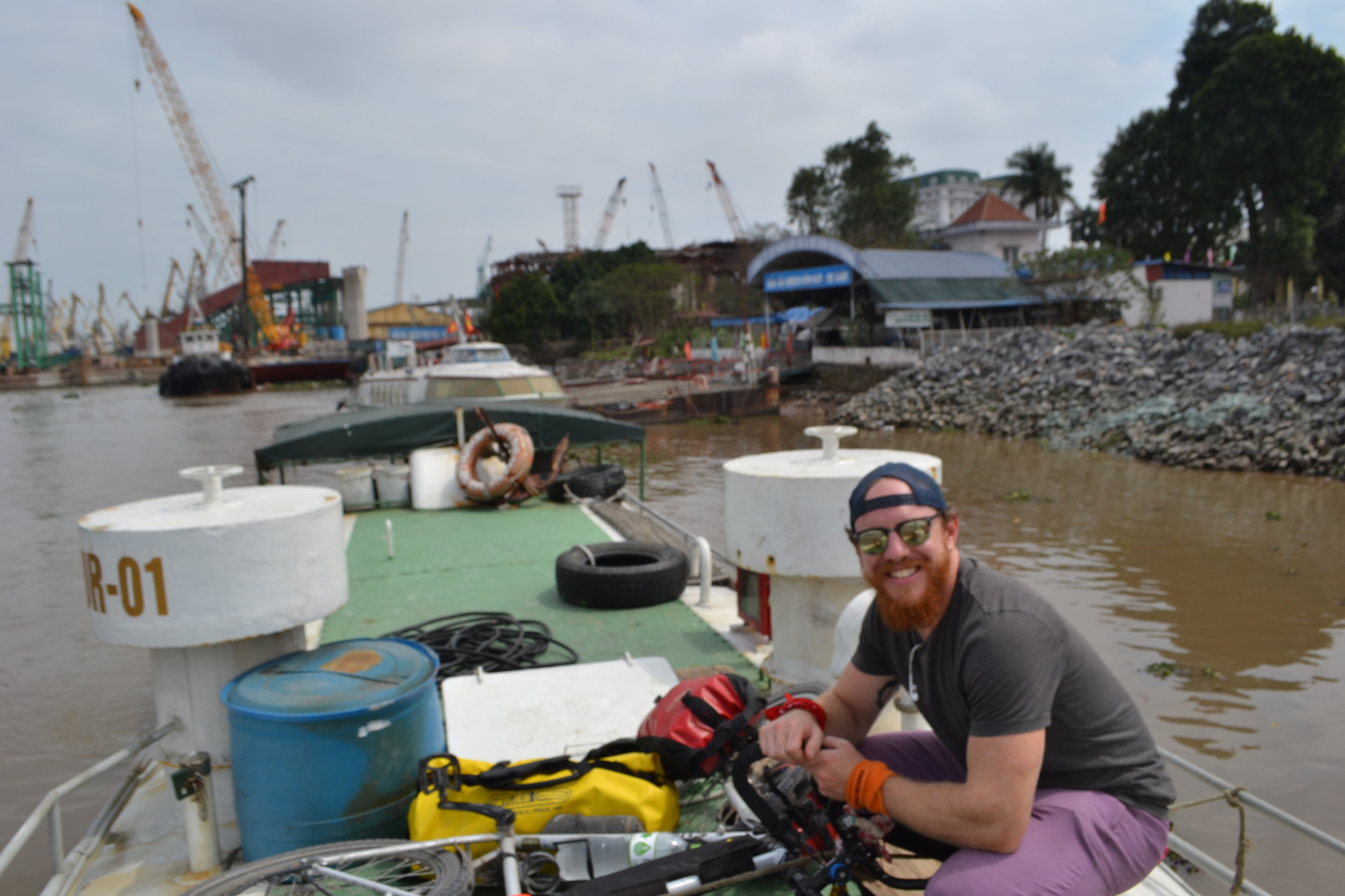 Tying my bike and bags to the top of the boat to Cat Ba Island.