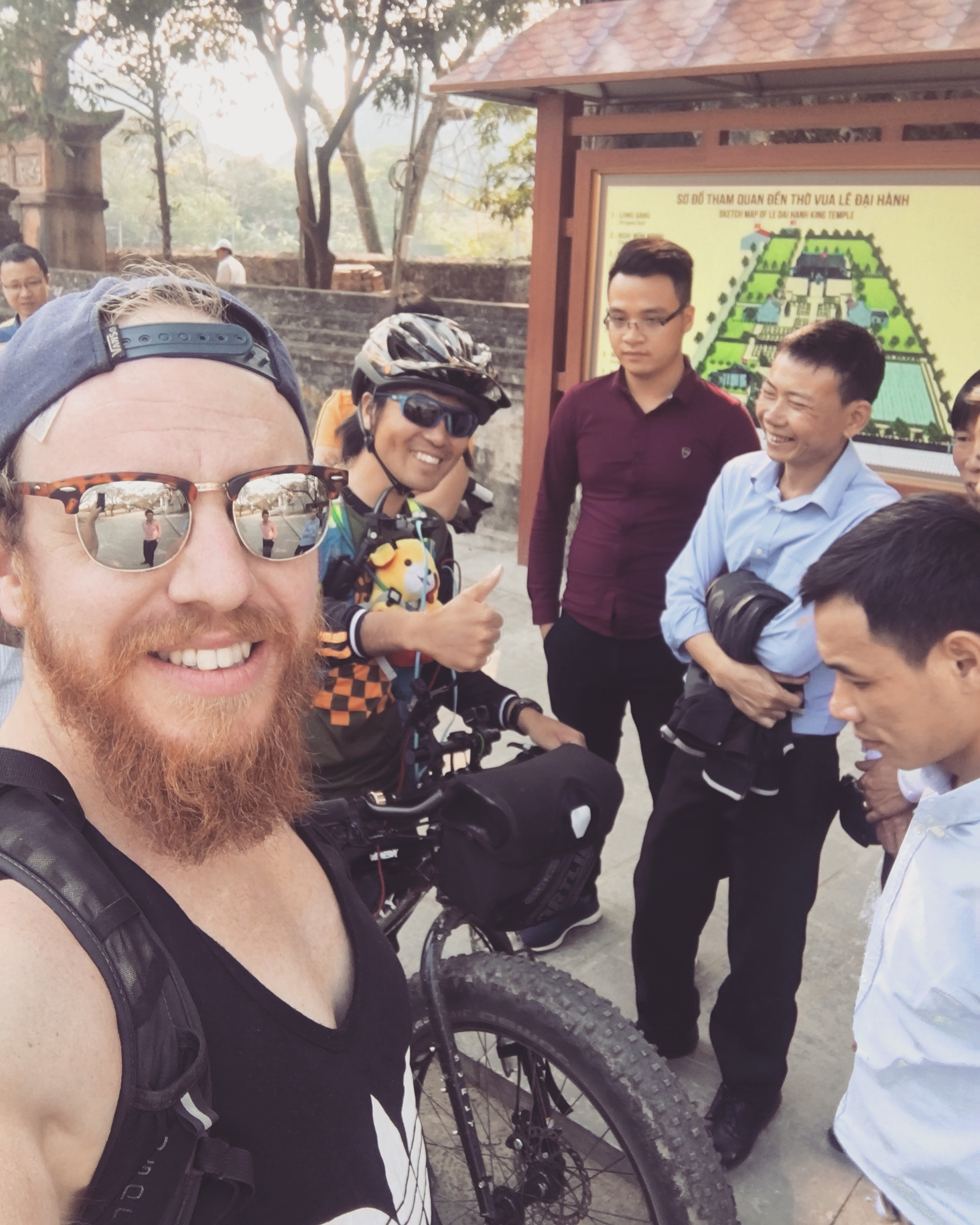 Mac and I surrounded by locals in Vietnams ancient former capital Hoa Lư
