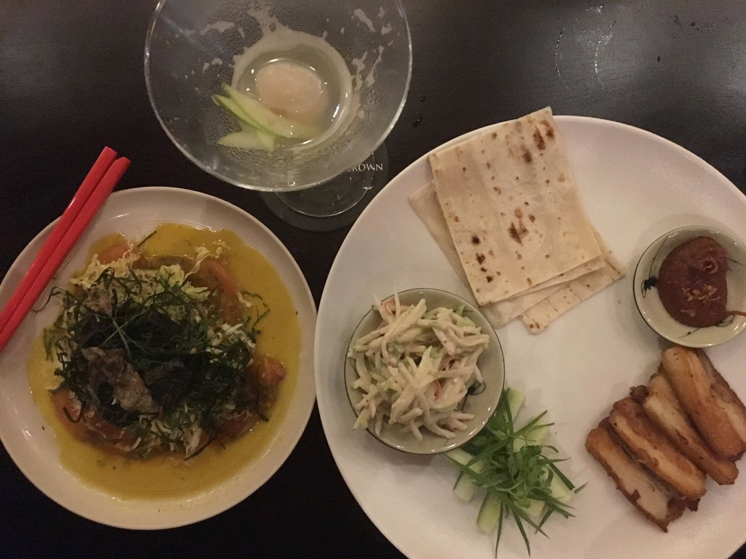 Salmon sashimi, with citrus, coconut and orange dressing, herb salad, crispy nori, shredded cabbage and crispy fish skin.  Sliced pork belly, soft tortilla wrap, served with a spicy, plum and tomato jam, Asian coleslaw and cucumber and spring onion.