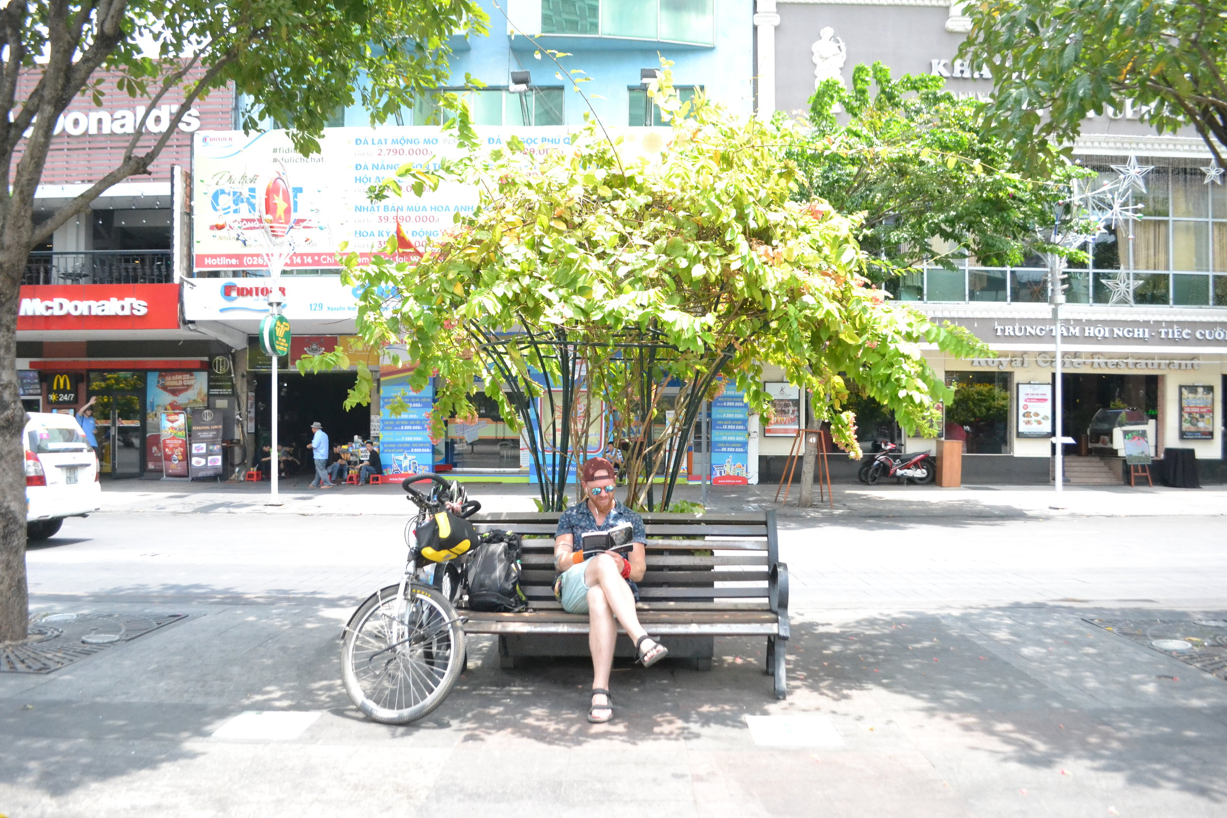 Taking a seat in the heart of Ho Chi Minh City after a day riding around.