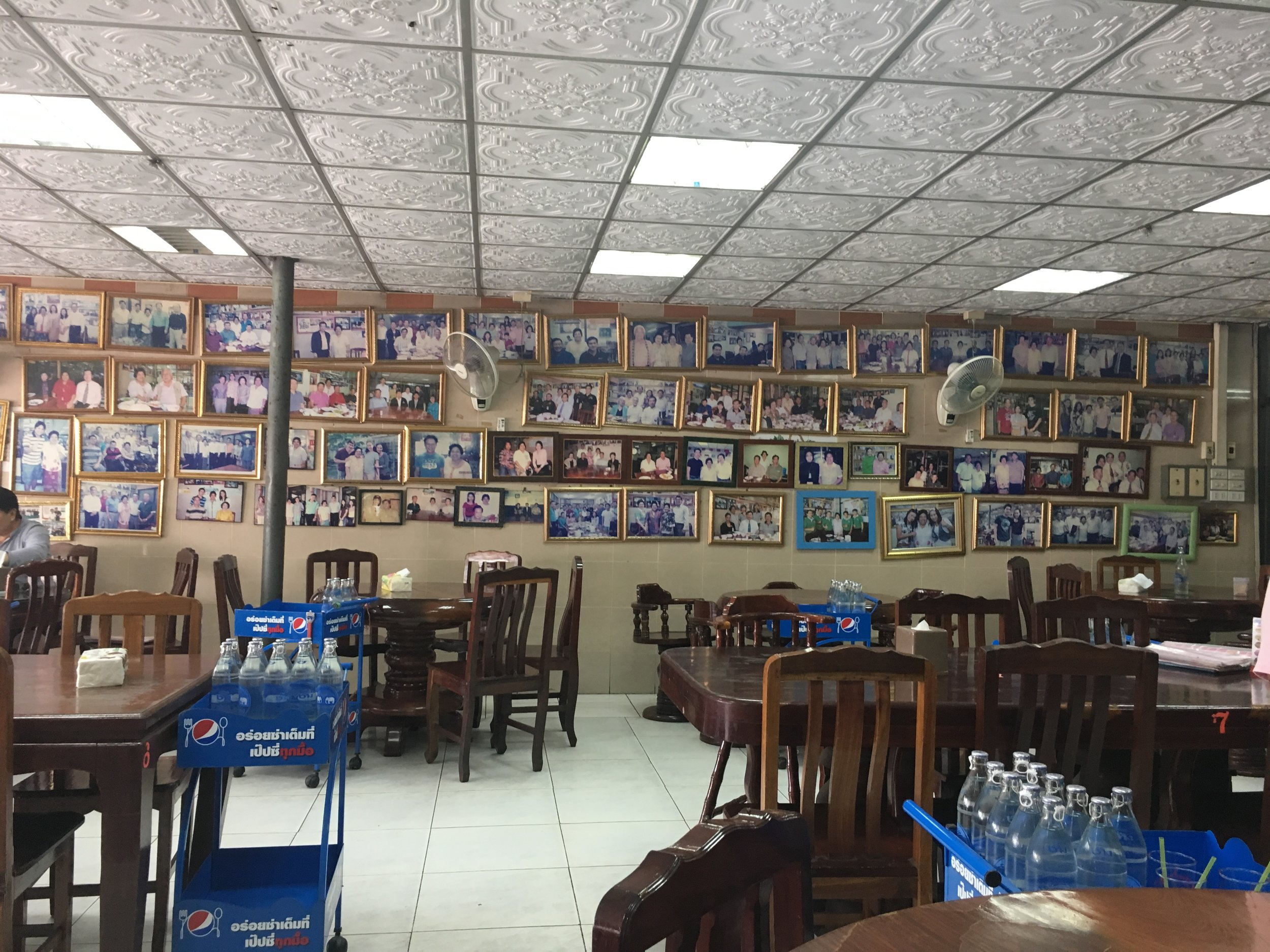 The walls of Je Dum restaurant laden with pictures of famous people and dignitaries