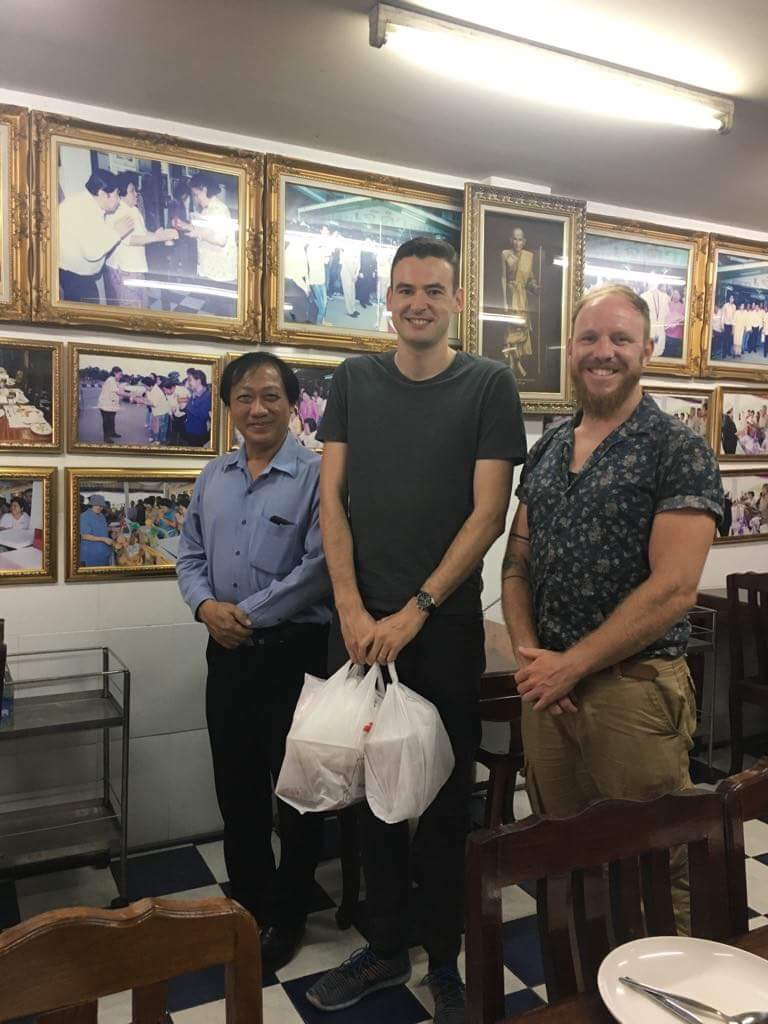 Khun Heng, Darren and I.  Notice the bags Darren is holding. Khun Heng had ordered takeout as well to fly back to Lampang with for dinner for his wife. I thought that was great.