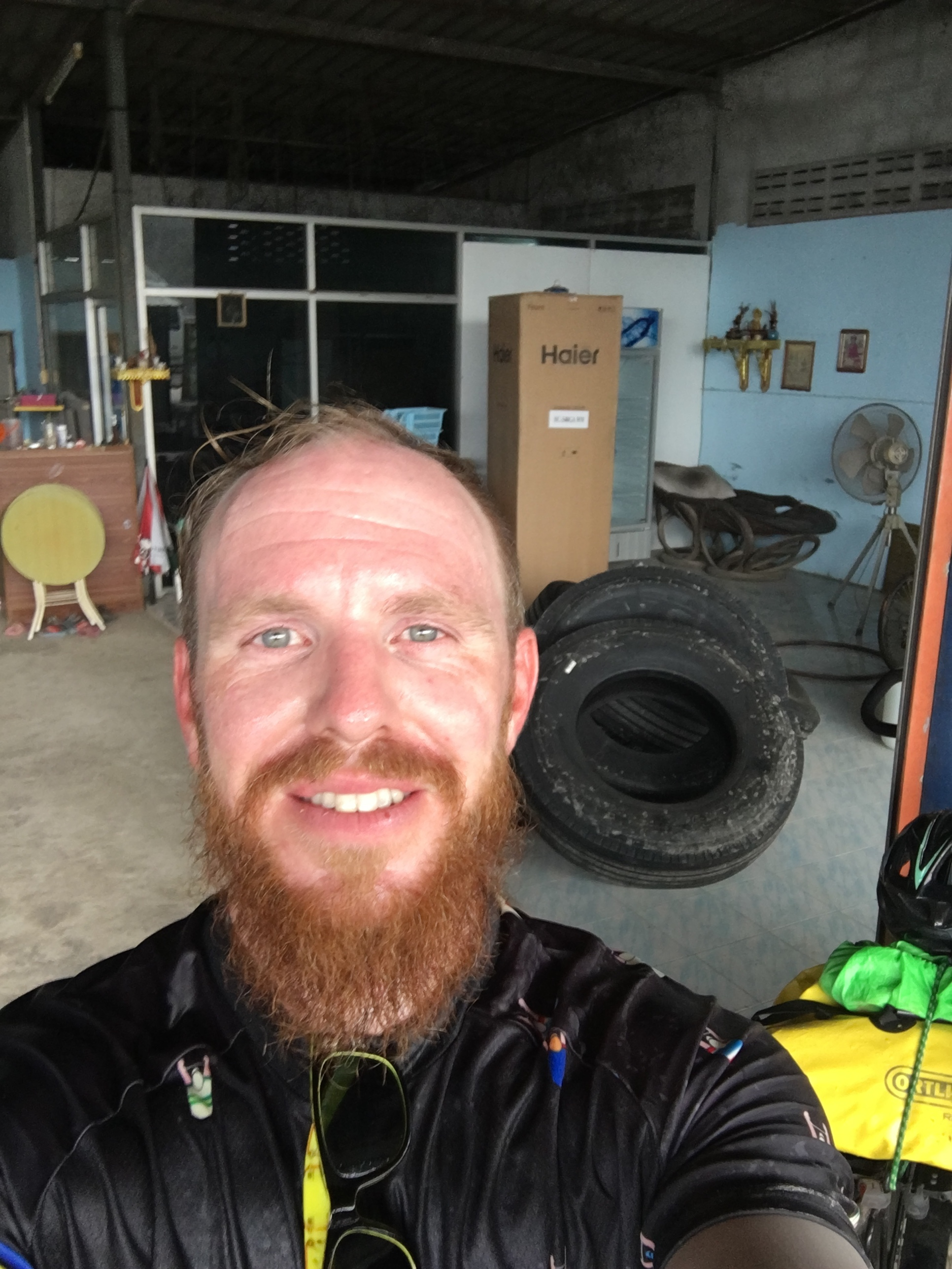 Out of the torrential rain in a kind mans mechanic workshop.