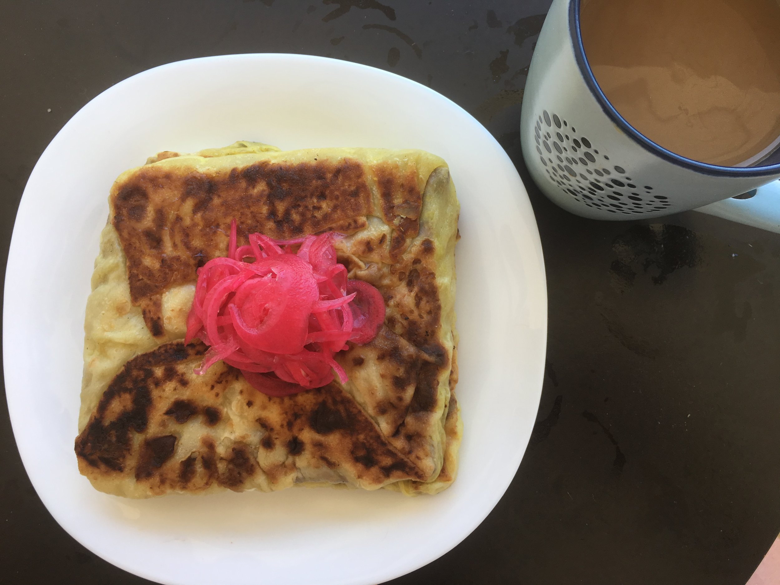 Cold Murtabak with sweet pickled onions for breakfast. Outstanding
