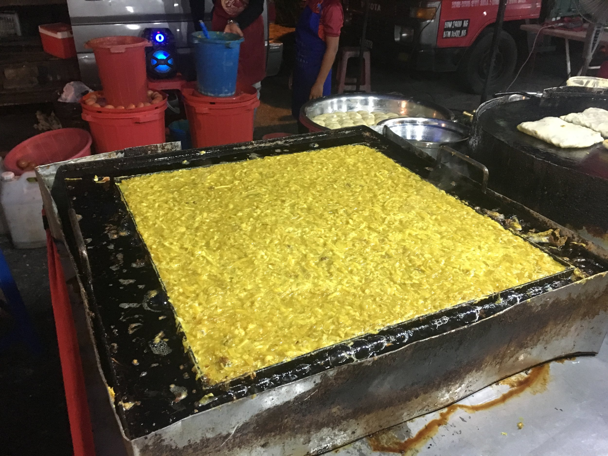 Making the filling. Onion, potato, egg, cabbage spices, all fried in ghee on a hot plate
