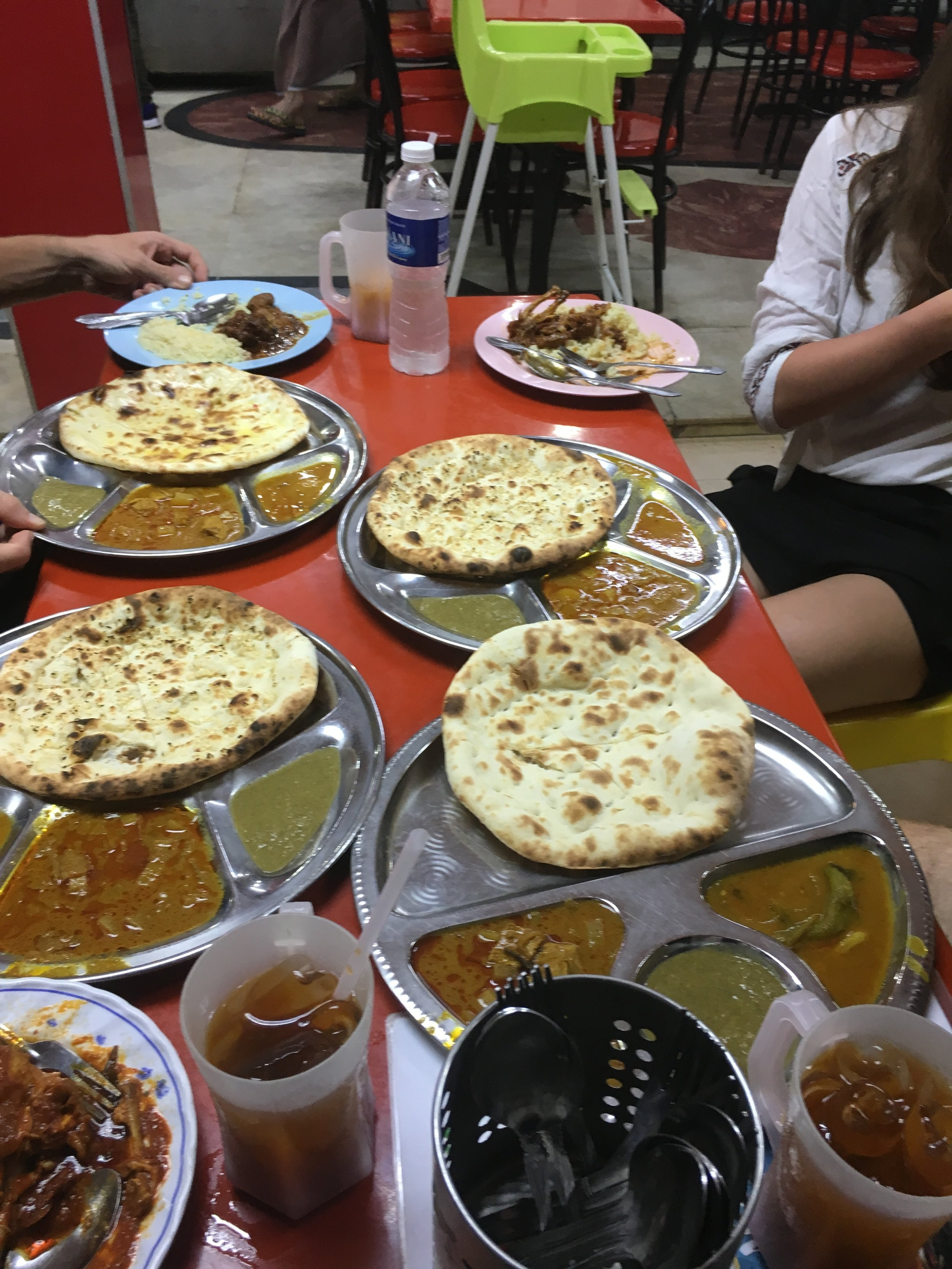 Naan all round. It is a meal in itself as it comes with 3, small vegetarian curries.
