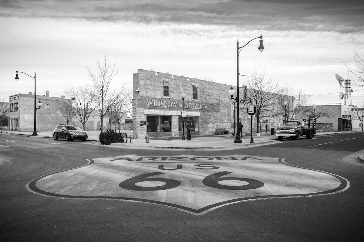Charly McConnell_Get Your Kicks on Route 66_Standing on Corner in Winslow.jpg
