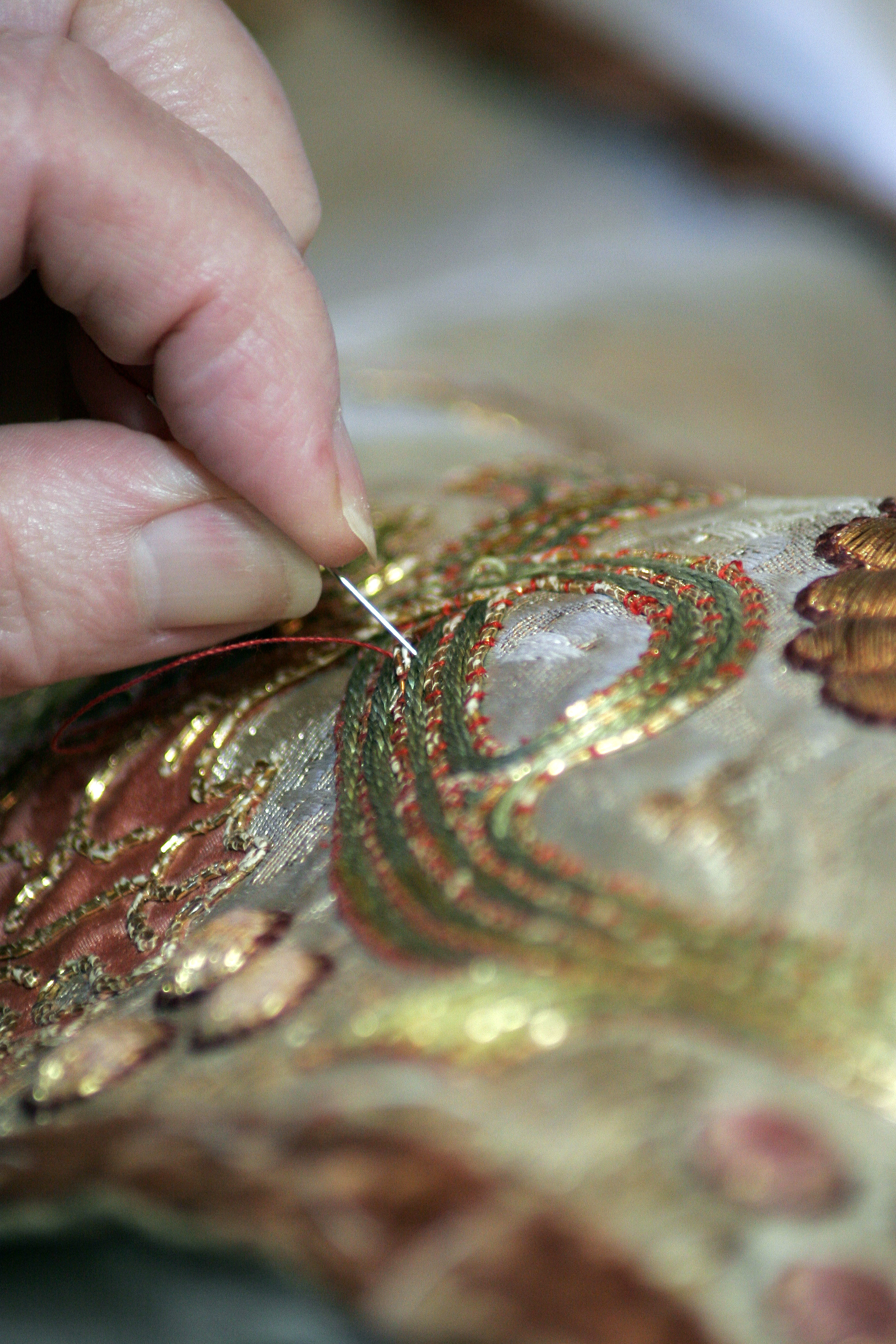 Photo by robbie munn of the embroiderers hard at work
