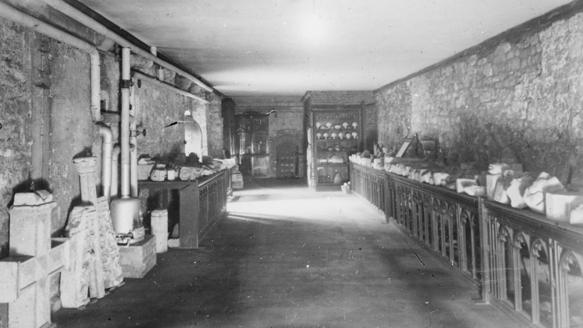 Figure 5. Photograph c.1900 of the stone fragment collection established by George Payne, F.S.A. in the Slype.