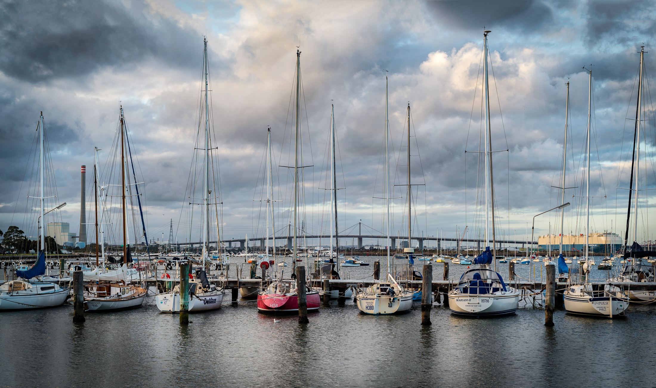 A row of yachts watch the autumn sunset across Hobsons Bay in Williamstown (Victoria, Australia) - Photo by Paul Tadday