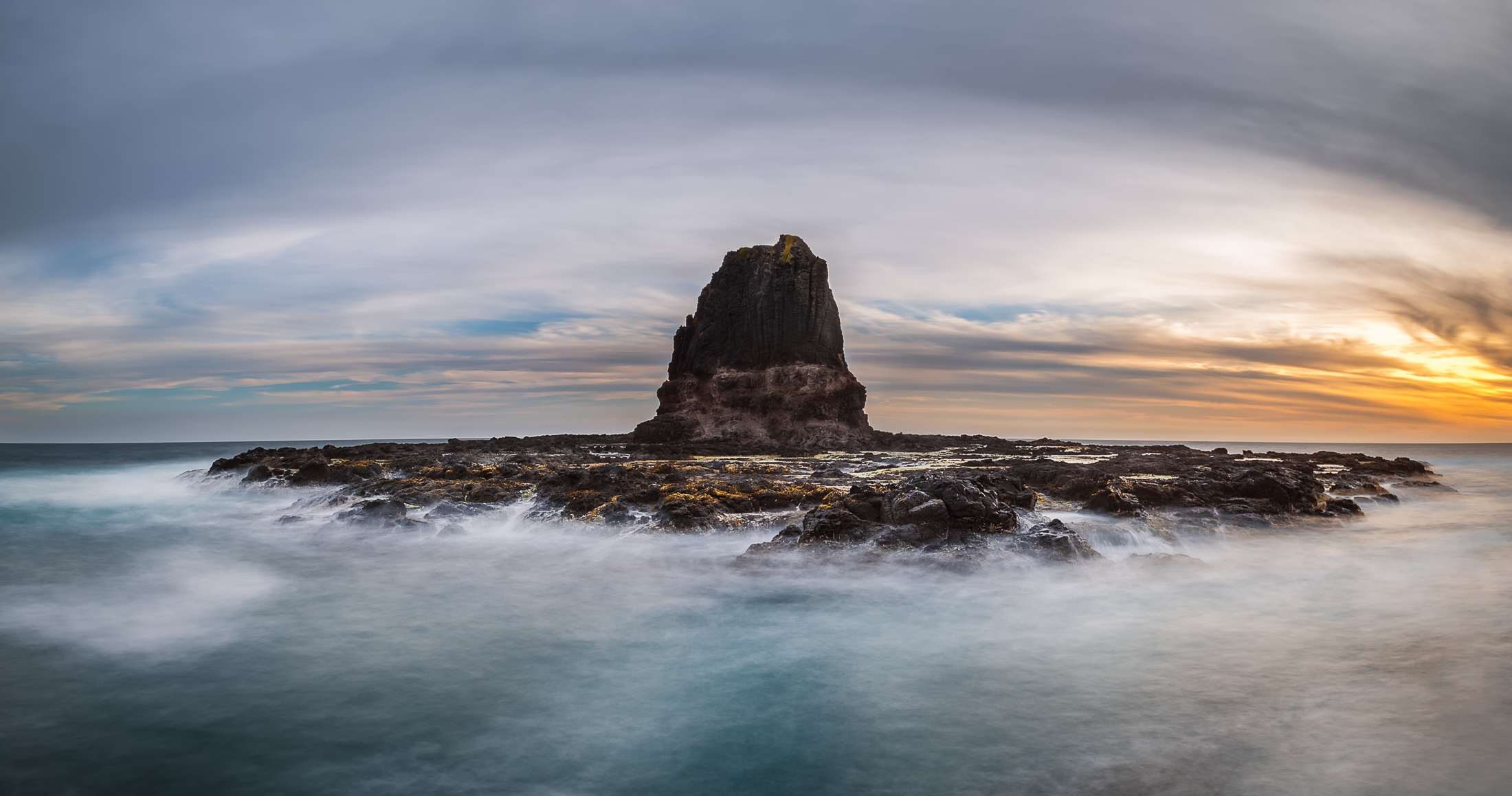 A sunset panorama of Pulpit Rock at Cape Schanck, Victoria, Australia - Photo by Paul Tadday
