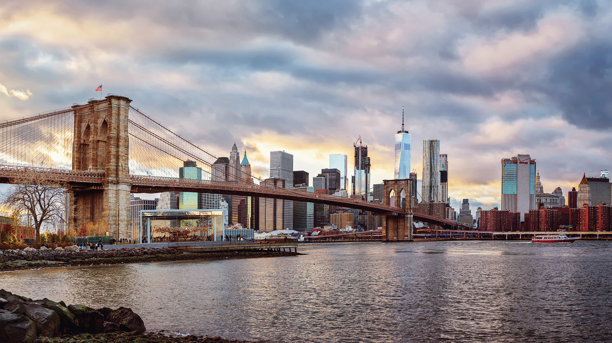 The Brooklyn Bridge and New York Manhattan Skyline at sunset viewed from DUMBO - Photo by Paul Tadday