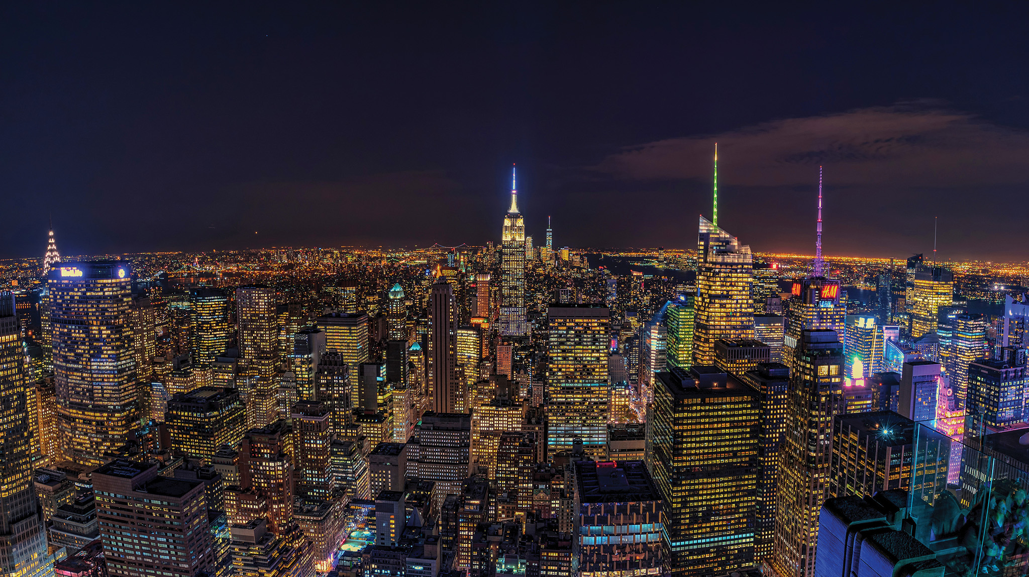 "The Empire State Building and New York skyline at night from ""The Top Of The Rock"" - Rockerfeller Centre - Photo by Paul Tadday"