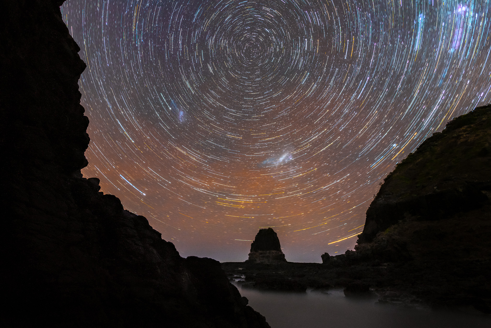 Star trails over Pulpit Rock at Cape Schanck (Mornington Peninsula, Victoria, Australia) - Photo by Paul Tadday