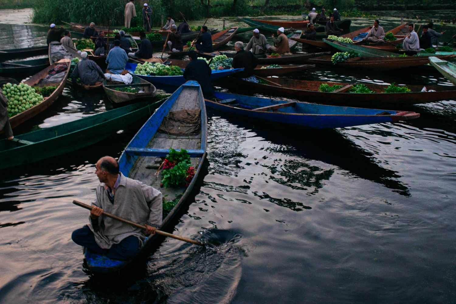Vendors ply their trade at the floating market.